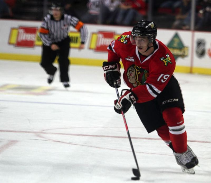 by: TRIBUNE PHOTO: JONATHAN HOUSE - Nic Petan moves up the ice for the Portland Winterhawks in a recent game against Tri-City.