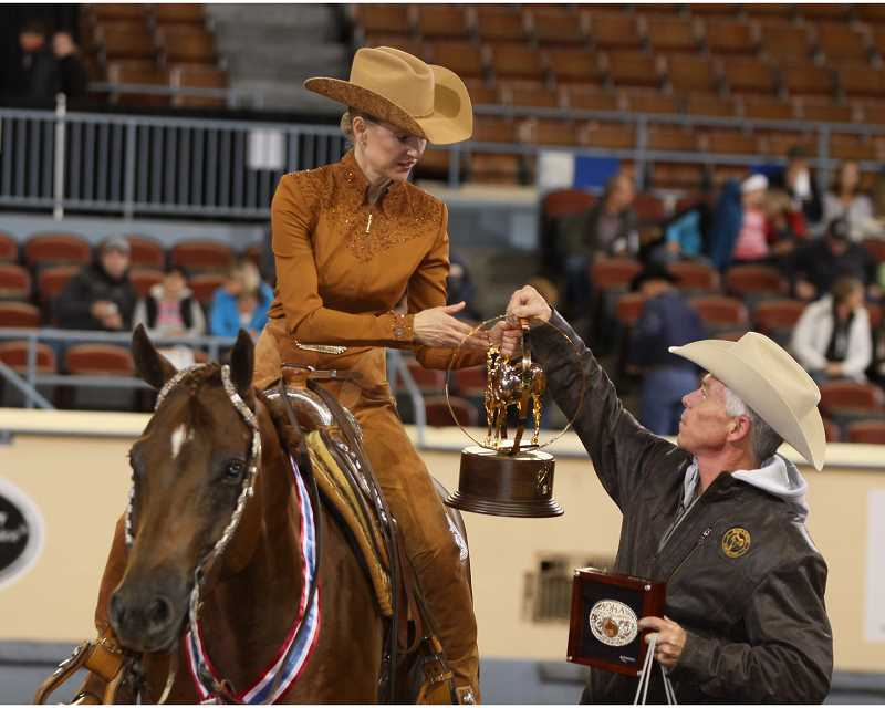 by: SUBMITTED PHOTO: AMERICAN QUARTER HORSE JOURNAL - Stephanie Richardson of Wilsonville captured the world championship title in amateur western horsemanship at the American Quarter Horse Association 2013 Bank of America Amateur World Championship Show on Nov. 13 in Oklahoma City.