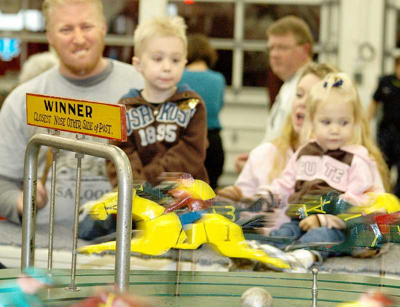 by: GARY ALLEN - Crowd favorite - Anyone familiar with the annual Turkey Carnival knows the horse racing machine has been a favorite with children and adults alike for the past 70 years.