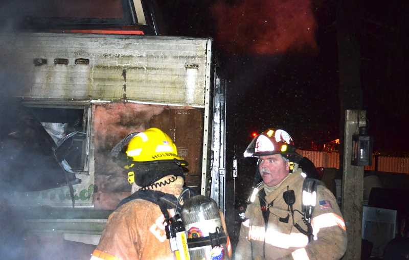 by: CONTRIBUTED PHOTO - Estacada firefighters help extinguish a shop fire in Oregon City.