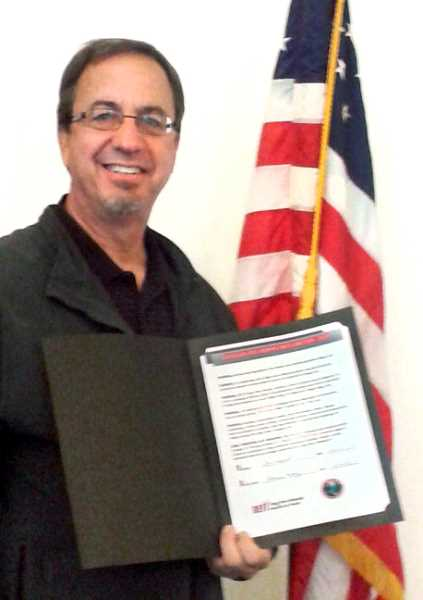 Photo Credit: ISABEL GAUTSCHI - Mayor Brent Dodrill holds up a proclamation for Red Ribbon Week in October. 'I consider it a privilege to be in the position I am,' Dodrill said of his office as mayor.