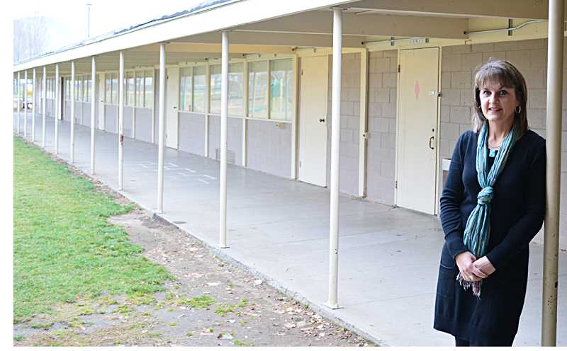 by: PHOTO BY CINDY DIX - Culver Superintendent Stefanie Garber's wait for election results is over, with the certification of the 590-585 vote approval of Culver School District's bond levy. Garber stands in front of one of the two cinder block elementary school wings that will be torn down and rebuilt.