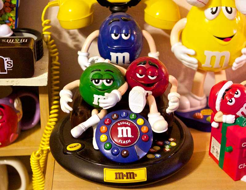 by: TIMES PHOTO: JAIME VALDEZ - This M&Ms candy phone is one of thousands of collectibles Gerald Barron owns in his Tigard home.