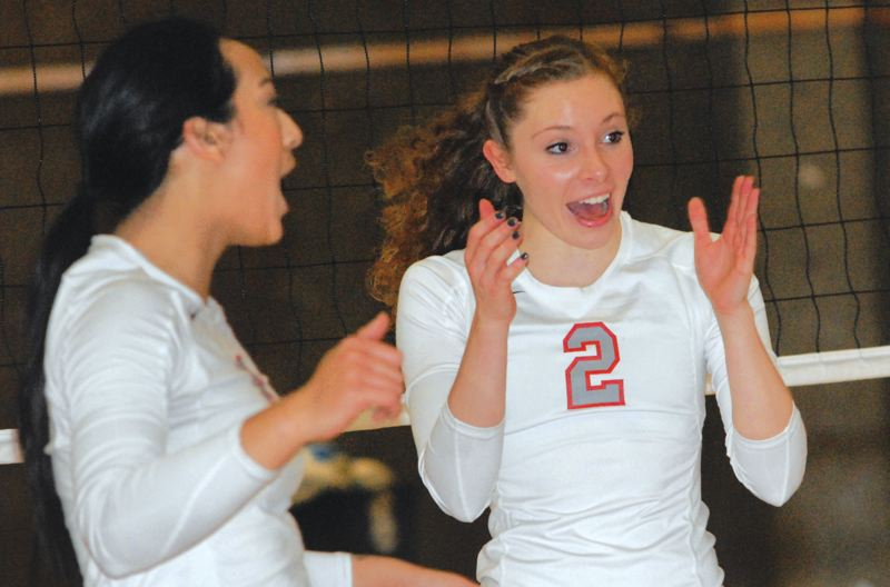 by: THE OUTLOOK: DAVID BALL - Mt. Hood teammates Keely Siegel and Lihau Perreira celebrate a point during a match last week.