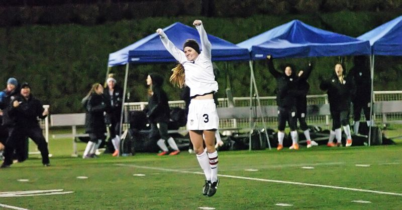 by: DAN BROOD - JUMPING FOR JOY -- Tualatin High School senior Jill Farley jumps into the air after scoring on a free kick to give the Wolves a 2-0 lead over Sunset in Saturday's Class 6A state championship match.