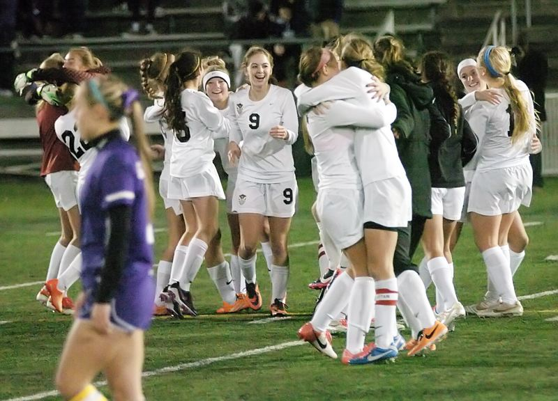 by: DAN BROOD - WE WIN -- The Tualatin High School girls soccer team starts celebrating following the victory over Sunset.