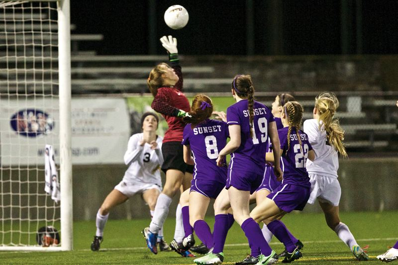 by: JAIME VALDEZ - I GOT IT -- Tualatin sophomore goalkeeper Emily Leonard goes up to grab the ball during first-half play Saturday at the Class 6A state championship match.