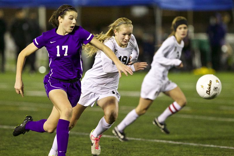 by: JAIME VALDEZ - ON THE RUN -- Tualatin High School freshman Anna Verloo (19) races to get to the ball ahead of Sunset freshman Rose Pflug in Saturday's title contest. Verloo helped the Timberwolves get the shutout.