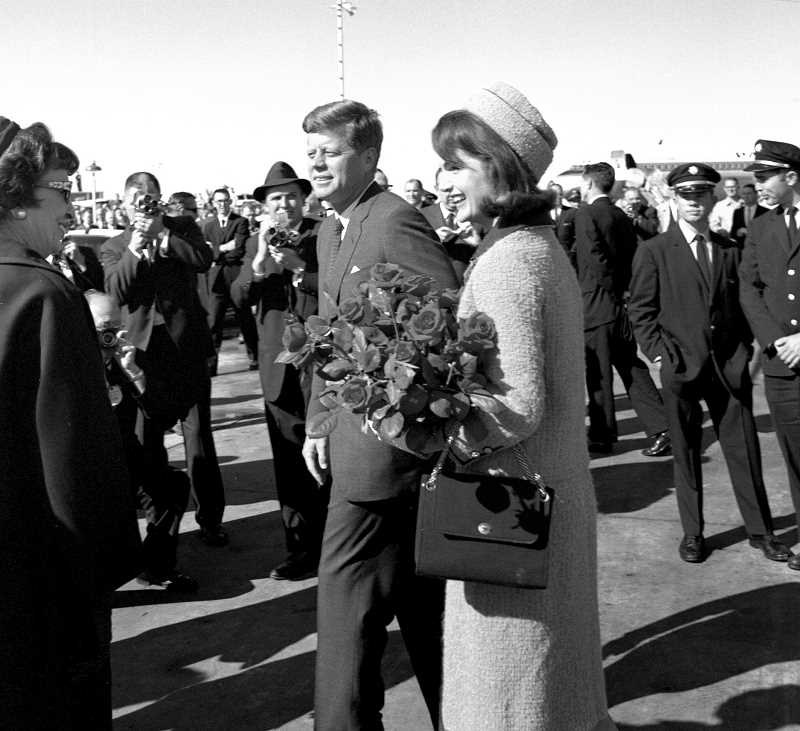 by: COURTESY OF JOHN F. KENNEDY PRESIDENTIAL LIBRARY: CECIL STOUGHTON. WHITE HOUSE PHOTOGRAPHS - President John F. Kennedy and Jacqueline Kennedy were given red roses when they arrived  at Love Field in Dallas on Nov. 22, 1963. His assassination hours later altered the course of U.S. history and changed lives.