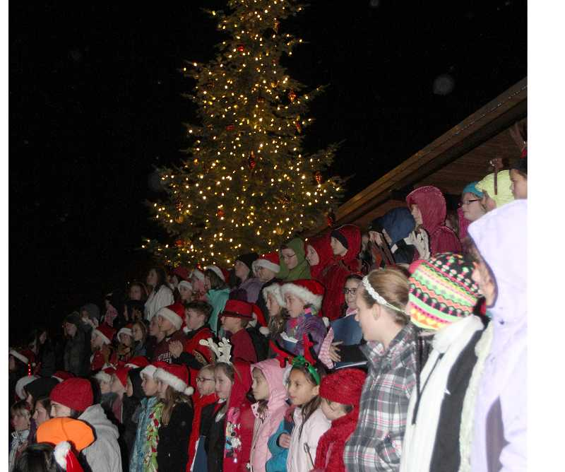 by: JONATHAN HOUSE - Last year's tree-lighting ceremony drew hundreds to the Old Cannery Plaza in Sherwood. The event is scheduled for Dec. 7 this year.