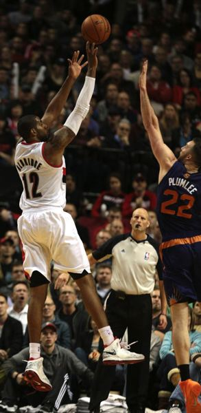 by: TRIBUNE PHOTO: JONATHAN HOUSE - Trail Blazers forward LaMarcus Aldridge lofts a shot over Miles Plumlee of the Phoenix Suns in a Nov. 13 game at Moda Center.
