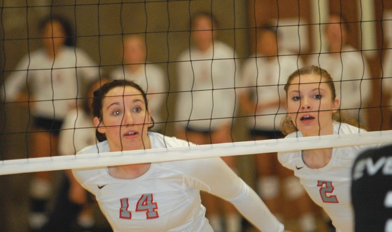 by: THE OUTLOOK: DAVID BALL - Mt. Hoods Devin Saucy, 14, and Keely Siegel look across the net while preparing to go up for a block during the third set Thursday against Everett.