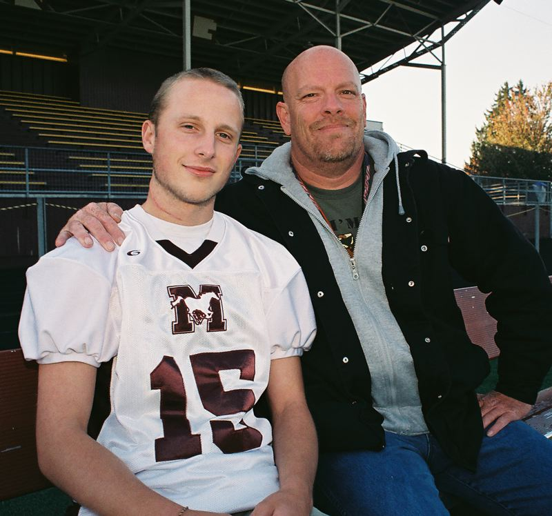 by: JOHN DENNY - Its been a rough fall for Milwaukie High School junior Aaron Walston and his family. Walston, pictured with his father Merit Walker, was diagnosed with thyroid cancer in August and missed most of the 2013 high school football season.