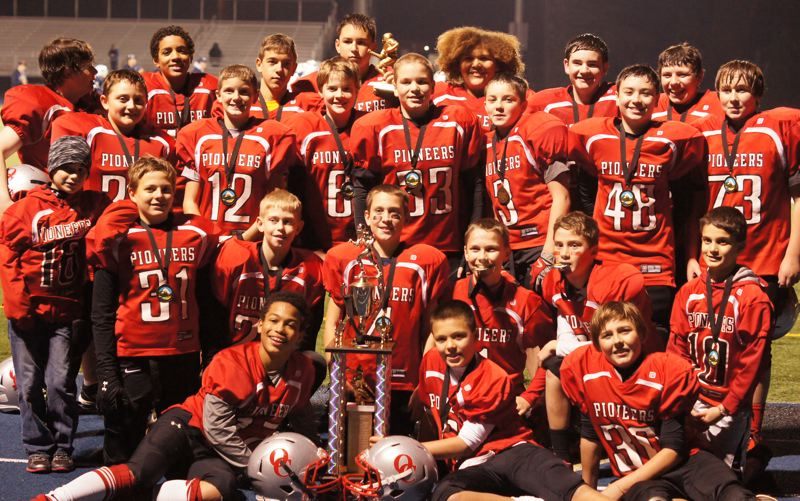 by: SUBMITTED - A TEAM TO WATCH! This group of seventh graders has gone 27-2 in youth football over the past three seasons, including 9-0 this year, when they hammered Southridge 31-13 in the championship game of the Tualatin Valley Youth Football Landry-Valley Division playoffs. Pictured are: (first row, from left) Zakhayas Lee, Colby Iverson and Dakota Miller; (second row) ball boy Davis Bell, Daniel Sytsma, Matthew Pavey, Redden Turner, Michael Bedell, Carter Bell and ball boy B.J. Phillips; (third row) Colby Dixon, Hunter Davis, Kevin Fullmer, Jacob Phillips, Truman Davis, Michael Young and Brock Duyck; and (back) Dawson Drews, Erich Nova, Luke White, Kelsen Hennessy, Isaiah Cook, Jordon Carnahan and Thomas Presnall.