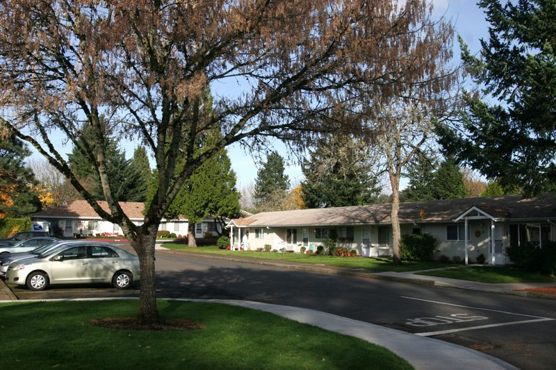 by: OUTLOOK PHOTO: JIM CLARK - Today, The Village Retirement Center is home to nearly 200 residents. The tree-lined streets are reminiscent of the way neighborhoods used to look.