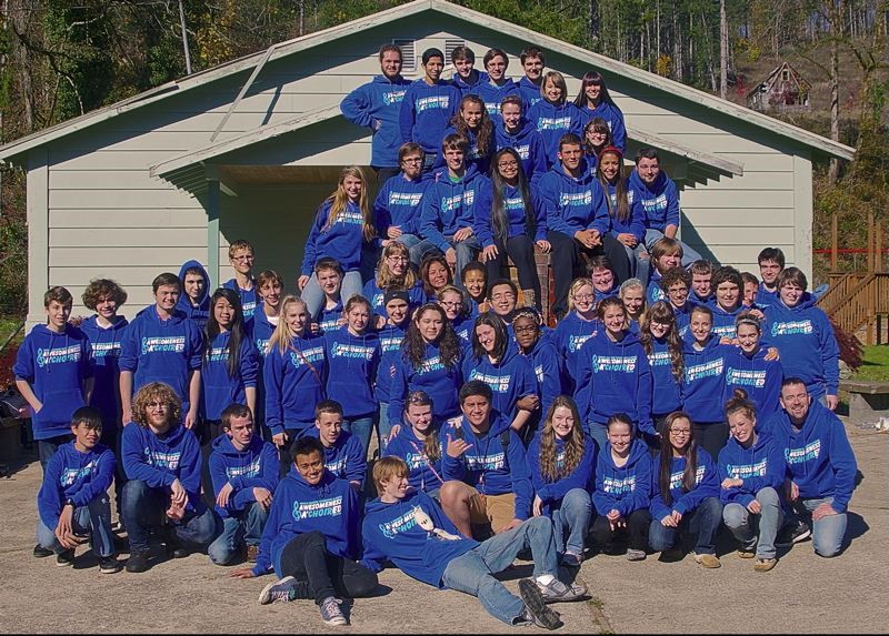 by: PHOTO COURTESY: SCOTT DAVIS - Clackamas High Schools A-Choir gathers this year at the Lewis River Camp in Washington for their retreat in October.
