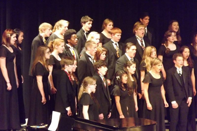by: PHOTO COURTESY: ERIKA LOCKWOOD - Rex Putnam High School belts out the chorus at its spring concert at Putnam earlier this year.