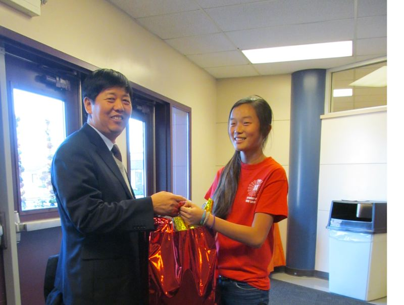 by: PHOTO BY ELLEN SPITALERI - Kraxberger Middle School student Renee Baker is pictured with visiting Principal Gaoyuan Lu.