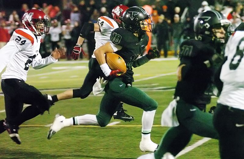 by: PAMPLIN MEDIA GROUP: DAN BROOD - Tigard senior Manu Rasmussen is on his way to scoring on a 69-yard run in the Tigers' 42-0 state quarterfinal win over North Medford.