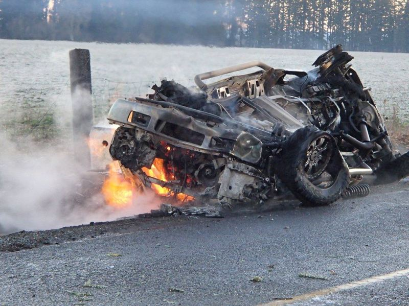 by: COURTESY OF CCSO - A pickup was burned Saturday morning in a crash that damaged a natural gas district regulator in rural Clackamas County near Molalla. Two people were hurt in the accident, one seriously.