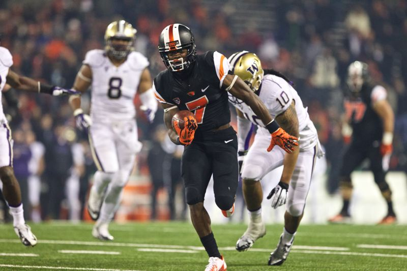 Brandin Cooks, Oregon State's standout receiver, heads for the end zone as the Beavers get on the scoreboard in the second half against the Huskies.