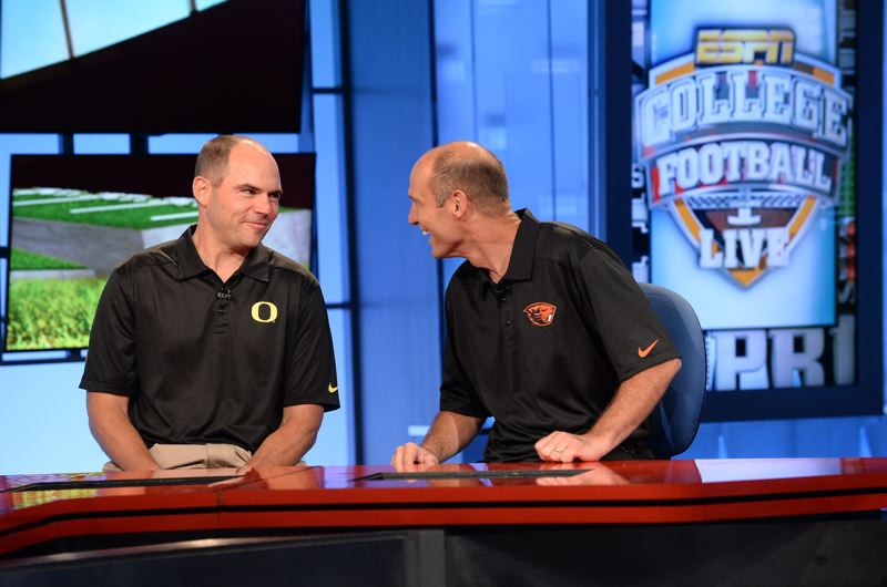 by: COURTESY OF PAC-12 CONFERENCE - Before the season, Oregon Ducks coach Mark Helfrich (left) and Oregon State coach Mike Riley shared some laughs on a Pac-12 Networks TV set.