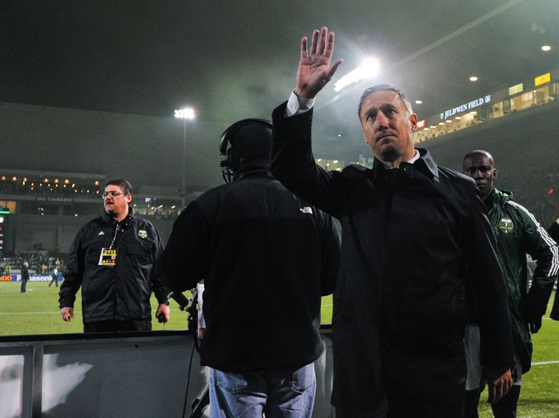 Timbers coach Caleb Porter waves good-bye.