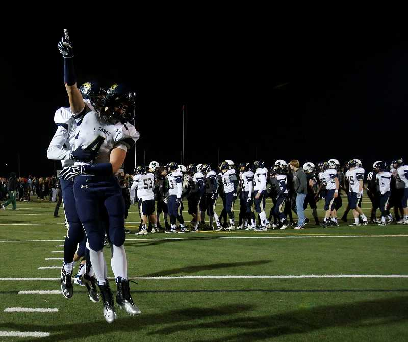 by: THE REGISTER-GUARD / COURTESY - A.J. Schlatter celebrates after the Canby football team defeats Eugene-Sheldon on the road in the Class 6A state semifinals Nov. 22.