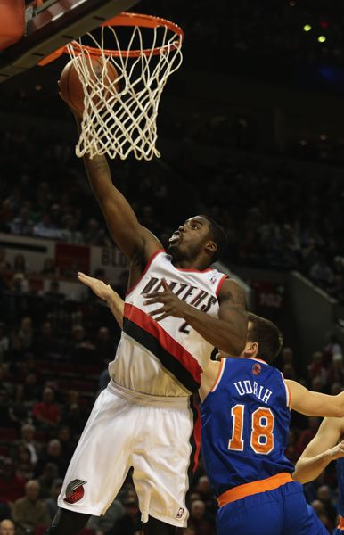 by: TRIBUNE PHOTO: JONATHAN HOUSE - Wesley Matthews slips by the Knicks' Beno Udrih for a layup, as Portland tops New York for its 11th consecutive NBA victory Monday night at Moda Center.