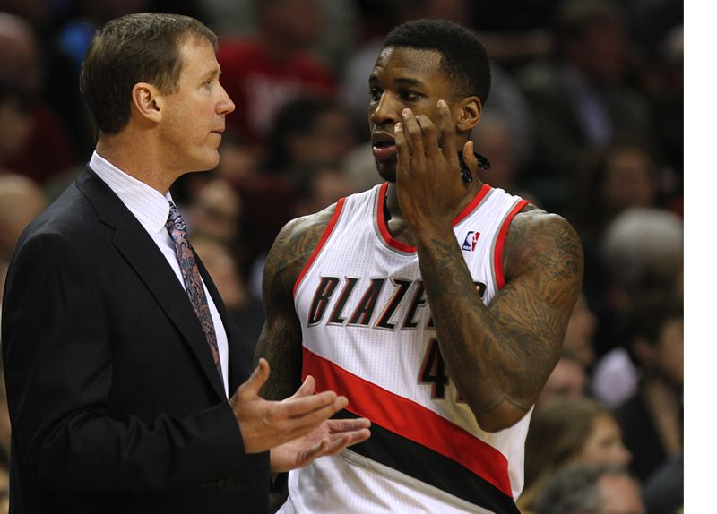 by: TRIBUNE PHOTO: JONATHAN HOUSE - Trail Blazers coach Terry Stotts confers with forward Thomas Robinson during Monday night's home victory over New York - which was Portland's 11th consecutive win and came on the coach's 56th birthday.