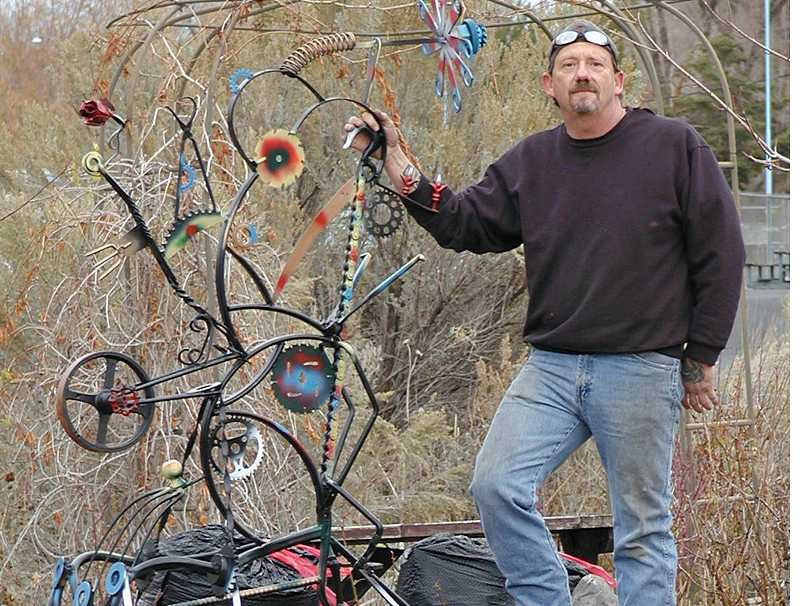 by: RON HALVORSON - Prineville resident Terry Lawrenz displays one of his metallic creations.