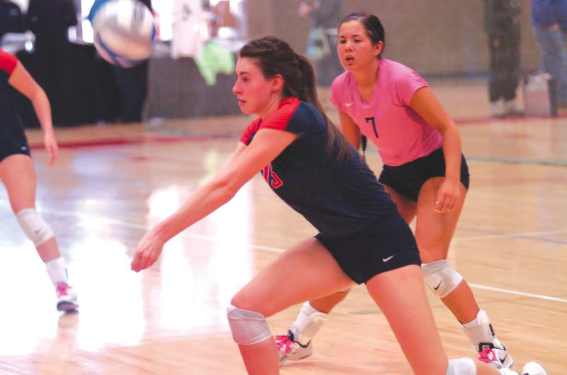 by: ESTACADA NEWS: PARKER LEE - Bre Gibbons of Clackamas CC gets in position for a dig during the teams opening-round win over Shoreline. She led the Cougars with 14 kills and 15 digs.