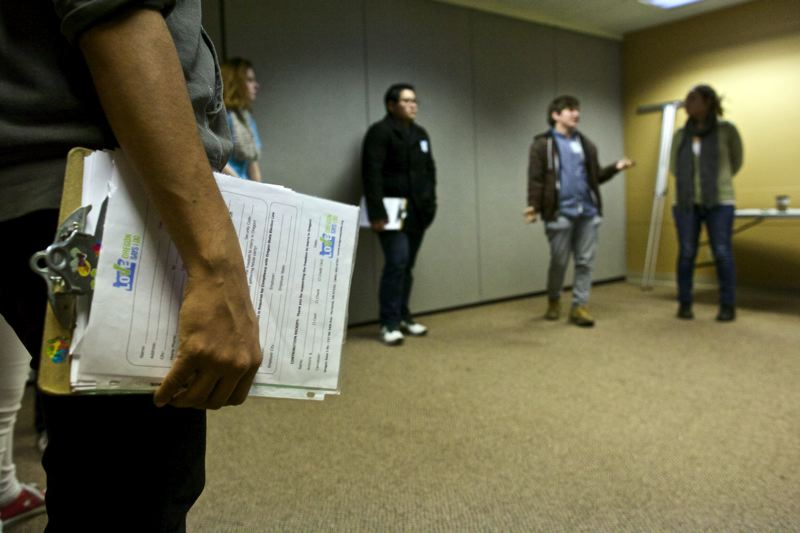by: TRIBUNE PHOTO: JAIME VALDEZ - Paid staffers for Oregon United for Marriage engage in role-playing at the Northeast Portland campaign headquarters, as training for door-to-door canvassing. The staff then knocked on doors to get petition signatures and campaign donations to promote gay marriage.