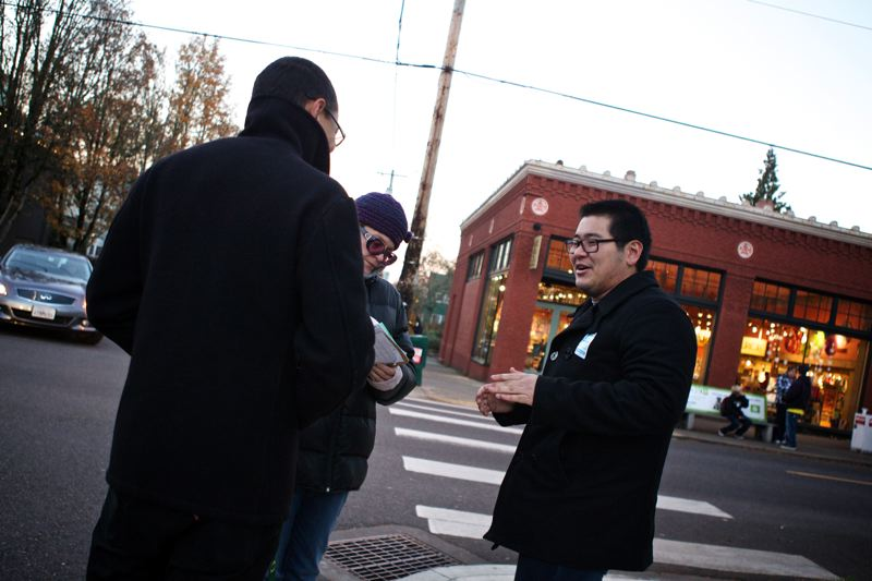 by: TRIBUNE PHOTO: JAIME VALDEZ - Nick Chun, a paid staffer for Oregon United for Marriage, talks with people on the street in Northwest Portland and gets a signature to support the gay marriage measure on next years ballot.