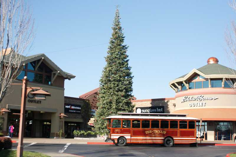 by: PHIL HAWKINS - Woodburn Premium Outlets' Christmas tree was lit Sunday.