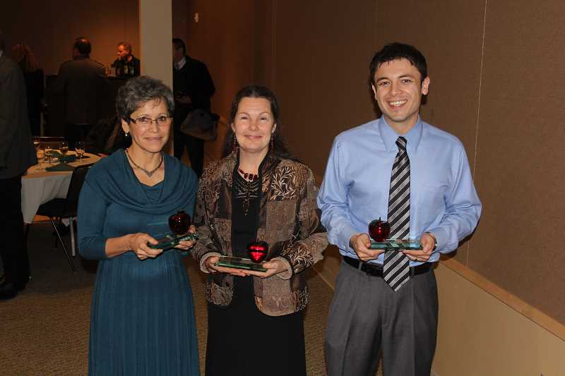 by: NIKKI DEBUSE - Crystal Apples were awarded to Woodburn educators (from left) Nuria Ellis, Kathy Kuftin and Juan Larios.