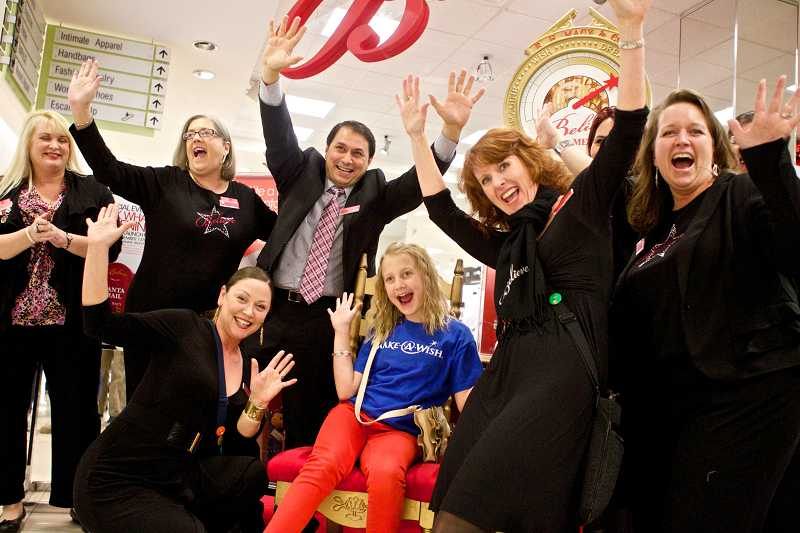 by: TIMES PHOTO: JAIME VALDEZ - The staff at Macy's at Washington Square mall help launch Macy's Believe Campaign with 12-year-old Lily Moser. The Make-A-Wish Foundation granted a wish for Moser two years ago.