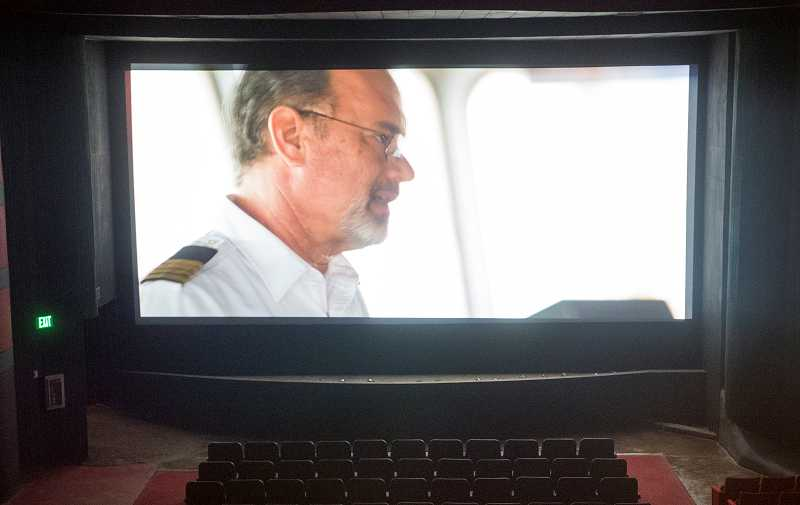 by: NEWS-TIMES PHOTOS: CHASE ALLGOOD - At 32.5 feet wide and 15 feet tall, the Forests screen (here showing Captain Phillips) is bigger than many megaplex screens. Only one of Cornelius 9s screens is bigger.