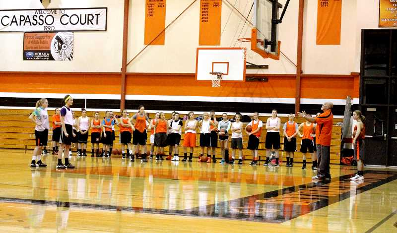 by: CORY MIMMS - Molalla's girls look to new Head Coach Phil Wiesner. They've been on the court preparing for their first game, which is at home on Dec. 4 versus Cascade.