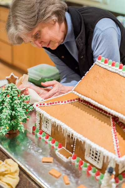 Morris worked on the gingerbread architecture of a sweet A.T. Smith house for several days.