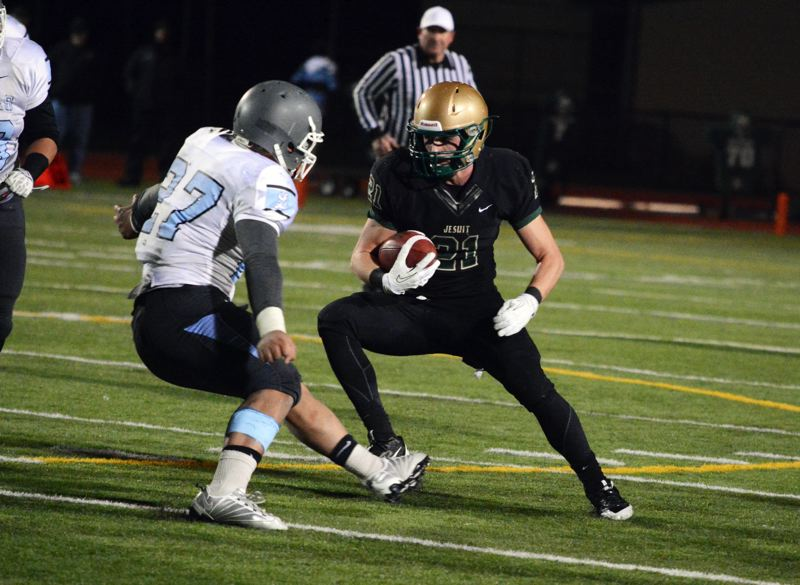 by: TIMES PHOTO: MATT SINGLEDECKER - Jesuit senior safety Trent Werner and the Crusaders came out on the right side of a brutal, flag-filled 6A state quarterfinal contest against Lakeridge on Friday. Both teams combined for 31 penalties on the night.