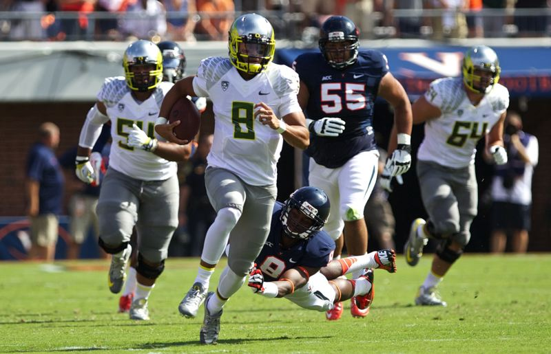 by: TRIBUNE FILE PHOTO: JAIME VALDEZ - Earlier in the season, Oregon quarterback Marcus Mariota sprinted into the open field against Virginia and other teams.