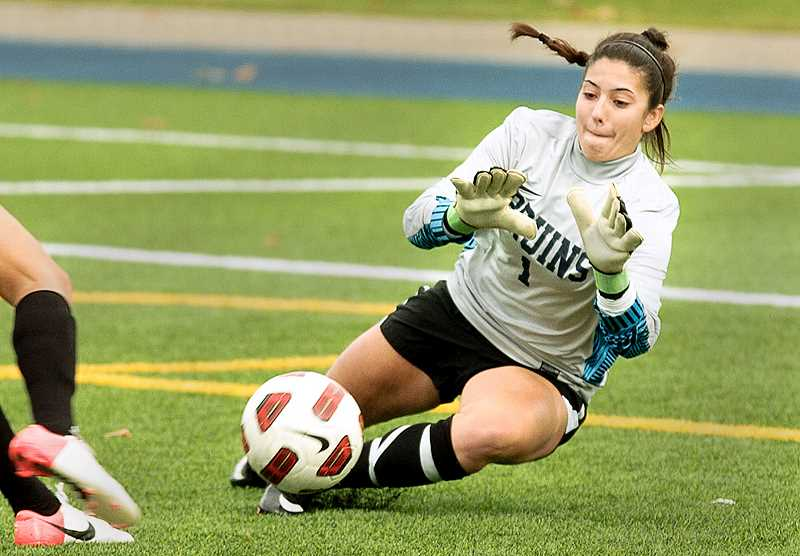 by: COURTESY OF GEORGE FOX UNIVERSITY - Last line of defense - GFU senior Alyssa Montero drops to make a save this fall. Montero was named Northwest Conference defensive player of the year after leading the conference with 160 saves and setting a school record for save percentage at .856.