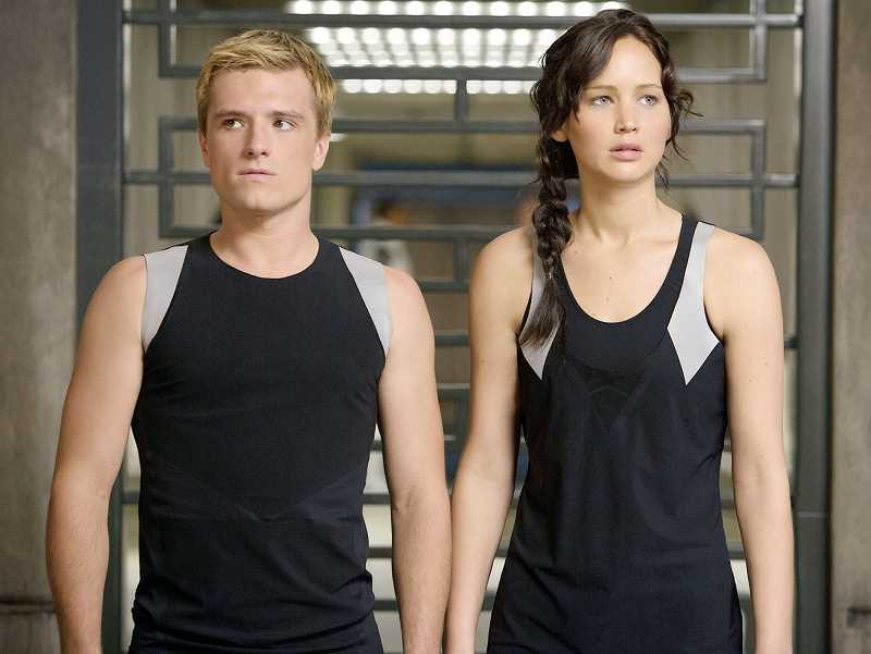 by: PHOTO COURTESY OF LIONSGATE PICTURES - Adventure - 'Peeta Mellark' (Josh Hutcherson) and 'Katniss Everdeen' (Jennifer Lawrence) face new dangers in 'Catching Fire,' the sequel to 'The Hunger Games.'