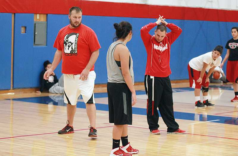 by: BILLY GATES/THE PIONEER - Madras High School co-coaches Zach Lillebo (left) and Rory Oster (right) instruct during Monday's practice at Madras High School.