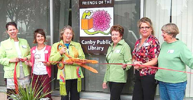 by: SUBMITTED PHOTO - Members of Friends of the Canby Public Library officially open the Book Garden.