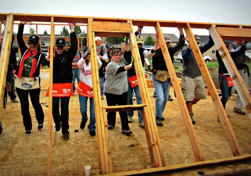by: CONTRIBUTED PHOTO - One of the requirements of the Habitat for Humanity home ownership program is participation in the house-building process.