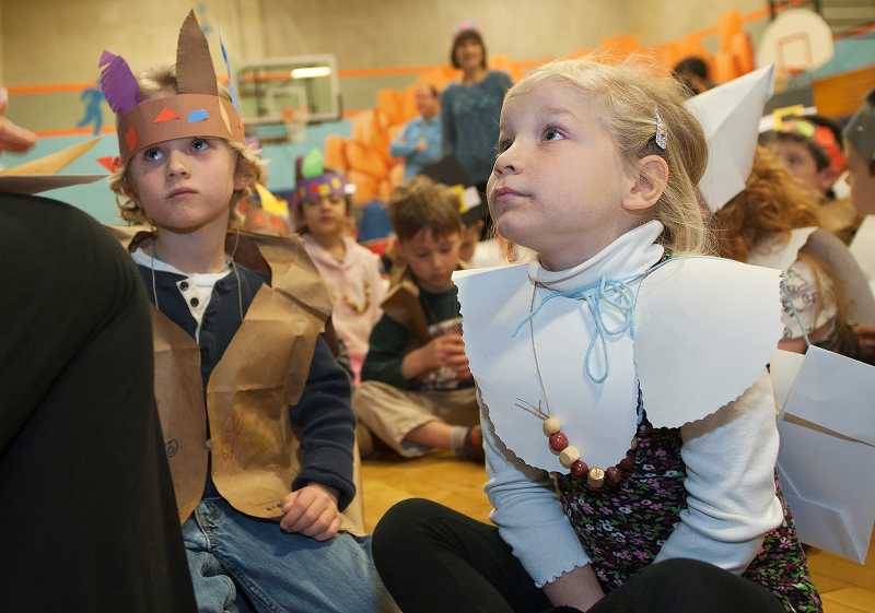 by: PAMPLIN MEDIA GROUP: JOSH KULLA - Westridge Elementary School kindergartners including, from left, Sam Bishop and Fenna Houben, participated in a Turkey Day feast on  Friday at Westridge Elementary School.