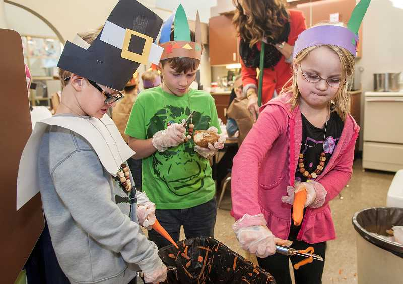 by: PAMPLIN MEDIA GROUP: JOSH KULLA - From left, Logan Beyer, Tennyson Herbert and Annie McGinnis, all kindergartners, prepare for the Thanksgiving feast last week at Westridge Elementary School.