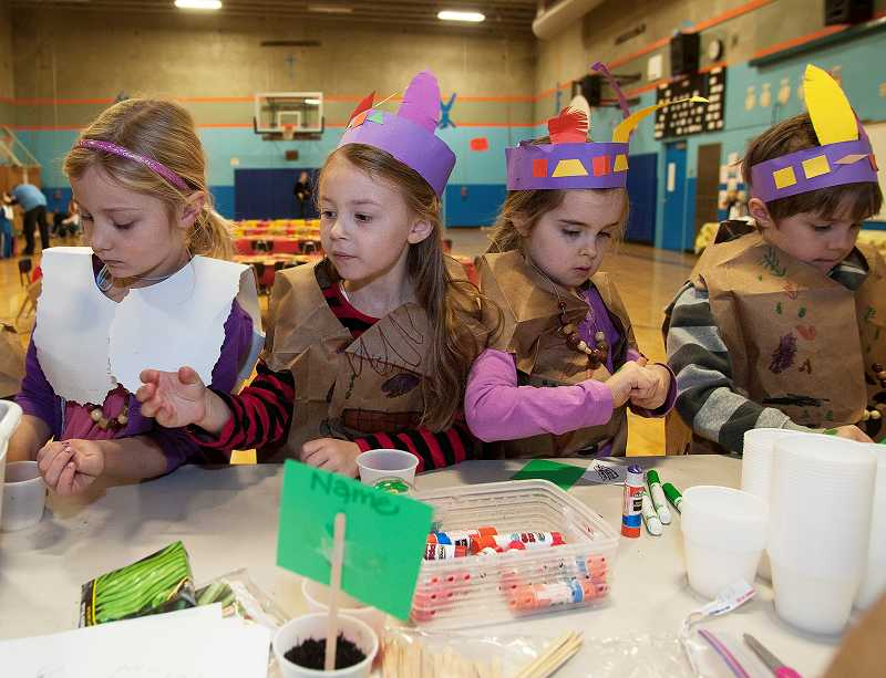 by: PAMPLIN MEDIA GROUP: JOSH KULLA - From left, Westridge Elementary kindergartners Ashlyn Weiler, Anna Hubbs, Cameron Bradley and Keegan Crosby make crafts.